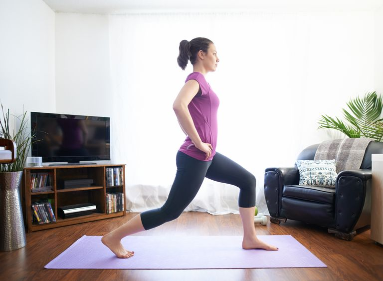 woman-stretching-at-home-581c88d15f9b581c0b0d4f09